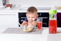 Young Boy Pushing Away Bowl of Breakfast Cereal Royalty Free Stock Photos