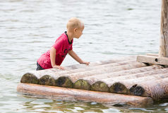 Young boy is pushing his raft Royalty Free Stock Image