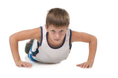 Young boy is pushing up Stock Photo