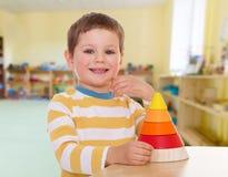 Young boy puts a pyramid Stock Photos