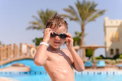 Young boy putting on goggles to go swimming Royalty Free Stock Image