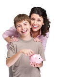Young boy putting its savings money in piggy bank Stock Image