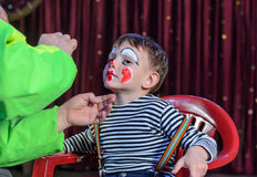 Young Boy Putting Mime Makeup for a Stage Play Royalty Free Stock Photography