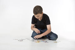 Young boy putting puzzle together Stock Photo