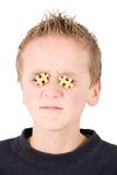 Young boy with puzzles in eyes Stock Image
