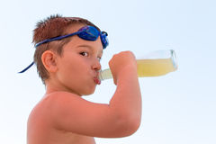 Young Boy Quenching his Thirst Stock Photo