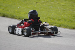 Young Boy Racing Go Kart. Young Go Kart Race Royalty Free Stock Photography