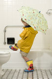 Young Boy in Rain Gear Stock Photo