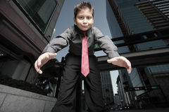 Young boy reaching towards the camera Stock Photography