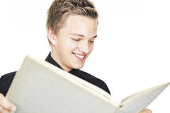Young boy reading. A young boy reading a big book Royalty Free Stock Photo