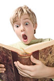 Young boy reading Stock Images