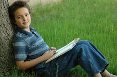 Young boy reading Stock Photo