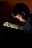 Young boy reading book stock photo