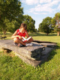 Young boy reading a book stock image