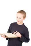 Young boy reading a book royalty free stock photography