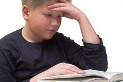 Young boy reading book close up. On white background royalty free stock images