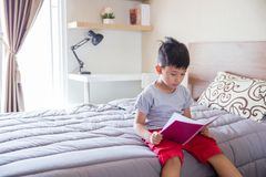 Reading a book at his bed Royalty Free Stock Images