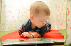 Young boy reading a book Stock Photography
