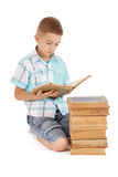 Young boy reading a old book Royalty Free Stock Images