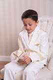 Young boy reading a prayer book Stock Images