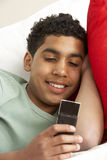 Young Boy Reading Text Message Royalty Free Stock Image