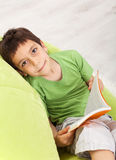 Young boy reads a book Royalty Free Stock Images