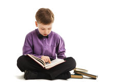 Young boy reads a book isolated Royalty Free Stock Image