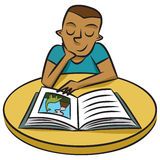 Young Boy Reads a Book Royalty Free Stock Image