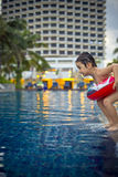 Young boy ready to jump in the pool Royalty Free Stock Photography