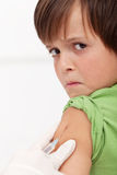 Young boy receiving injection or vaccine Stock Photography