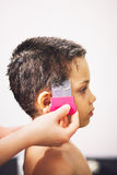 Young boy receiving lice treatment Royalty Free Stock Photos