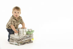 Young Boy Recycling In Studio Stock Image