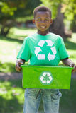 Young boy in recycling tshirt holding box Stock Photos