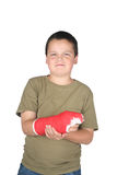 Young boy with red cast. Isolated on white background royalty free stock images
