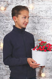Young boy with red flowers Royalty Free Stock Photography