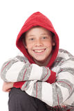 Young boy with red hood Stock Image