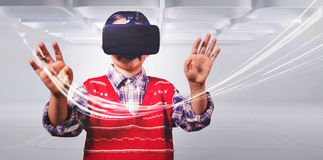 Young boy in red jumper with virtual reality headset stock image