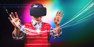 Young boy in red jumper with virtual reality headset stock photo