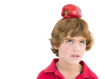 Young boy with red pepper on his head Stock Photo