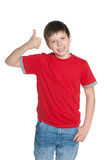 Young boy in the red shirt holds his thumb up Royalty Free Stock Images