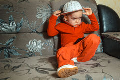 Young boy in red suit and cap Royalty Free Stock Photos