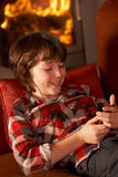 Young Boy Relaxing With MP3 Player Royalty Free Stock Photos