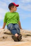 Young boy relaxing outdoors Stock Photos