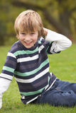 Young Boy Relaxing Outdoors Sitting On Grass Stock Photos
