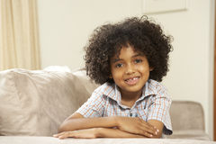 Young Boy Relaxing On Sofa At Home Stock Photos