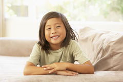 Young Boy Relaxing On Sofa At Home Royalty Free Stock Image