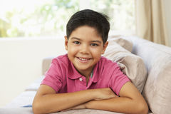 Young Boy Relaxing On Sofa At Home Royalty Free Stock Images