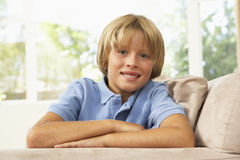 Young Boy Relaxing On Sofa At Home. Smiling Royalty Free Stock Image