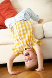 Young Boy Relaxing On Sofa At Home. Laughing At Camera Stock Photography