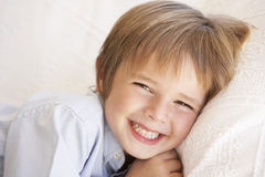 Young Boy Relaxing On Sofa At Home Royalty Free Stock Photos
